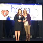 Lawrence receive award on stage at HOSA conference
